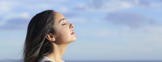 Profile of an arab woman breathing fresh air